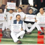 Congress MPs display 'T' placards in Parliament