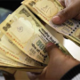 Rupee hits fresh all-time low of 65.50 Vs dollar